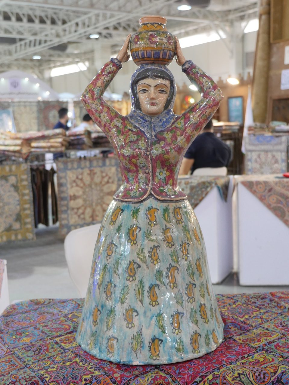 Pottery sitting on a termeh at the Handcrafts Exhibition