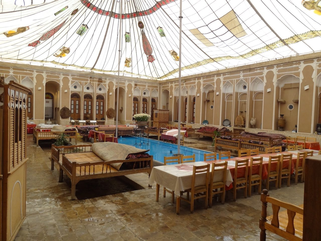Main courtyard with pool and canvas canopy